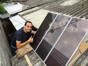 Adam Pervez With The Installed Solar Panels